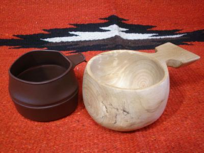 wooden cup with Swedish Plastic cup
